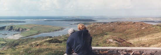 Looking out together at the untamed Irish coastline.